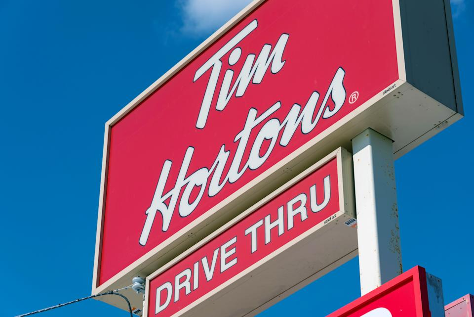 Tim Hortons drive through sign: Restaurant Brands' donut chain is known all over Canada for serving hot and delicious coffee and donuts. (Photo by Roberto Machado Noa/LightRocket via Getty Images)