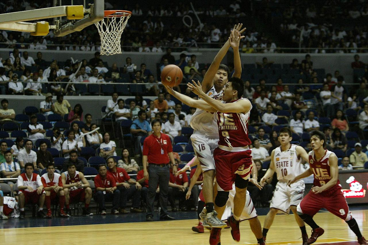 Paul Zamar of UE Red Warriors goes for the basket against UP Fighting Maroons during the UAAP Season 74 basketball game held at Smart Araneta Coliseum in quezon City. (Marlo Cueto/NPPA Images)
