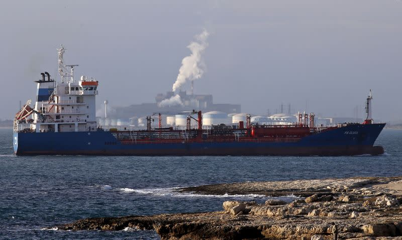 FILE PHOTO: An oiil tanker sits anchored off DPF oil refinery and the ArcelorMittal's steel plant on the site of Fos-sur-Mer near Marseille