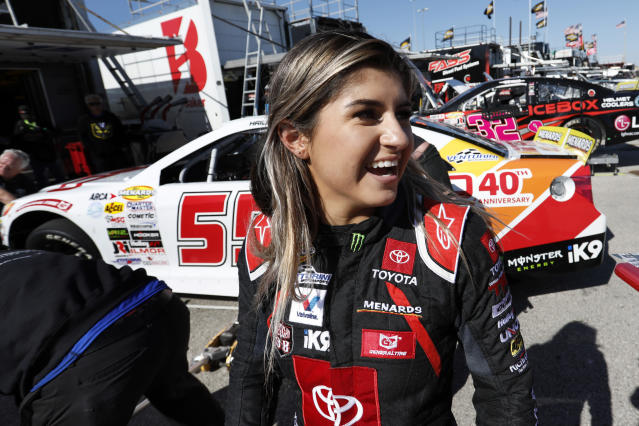 Driver Hailie Deegan greets fans after practicing for tonight's ARCA Series auto race at Kansas Speedway. (AP Photo/Colin E. Braley)