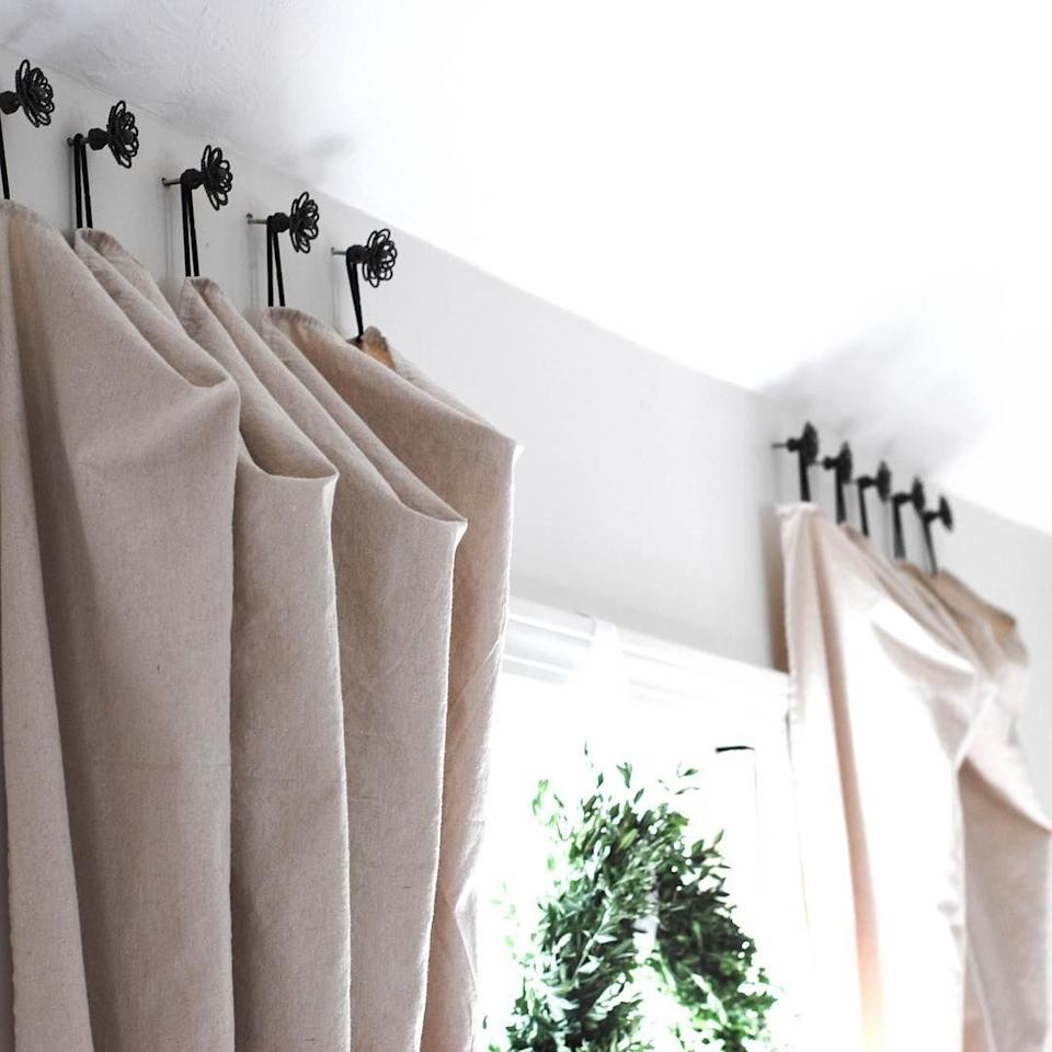 "<p>These drop-cloth curtains are made even better with Stephanie LeBlanc's innovative hanging technique. Instead of rings or rods, she used drawer pulls to add a little extra flair. </p><p><strong>See more at <a href=""https://www.instagram.com/p/Bj-vO2AlO1c/"" target=""_blank"">@celebrated_nest</a>. </strong></p><p><a class=""body-btn-link"" href=""https://www.amazon.com/Scunci-Damage-Elastics-Small-Black/dp/B01IAEHCN0/?tag=syn-yahoo-20&ascsubtag=%5Bartid%7C10050.g.31139160%5Bsrc%7Cyahoo-us"" target=""_blank""><strong>SHOP BLACK HAIR TIES</strong></a></p>"