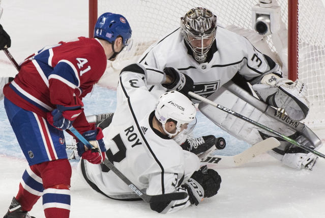 Los Angeles Kings goaltender Jonathan Quick makes a save against Montreal Canadiens' Paul Byron (41) as Kings' Matt Roy defends during the second period of an NHL hockey game Saturday, Nov. 9, 2019, in Montreal. (Graham Hughes/The Canadian Press via AP)