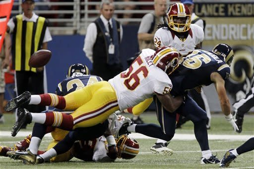 St. Louis Rams wide receiver Danny Amendola, right, fumbles as he is hit by Washington Redskins inside linebacker Perry Riley (56) and Redskins' DeJon Gomes (24) lwatches during the first quarter of an NFL football game, Sunday, Sept. 16, 2012, in St. Louis. Redskins' Josh Wilson ran the fumble back 30-yards for a touchdown. (AP Photo/Seth Perlman)