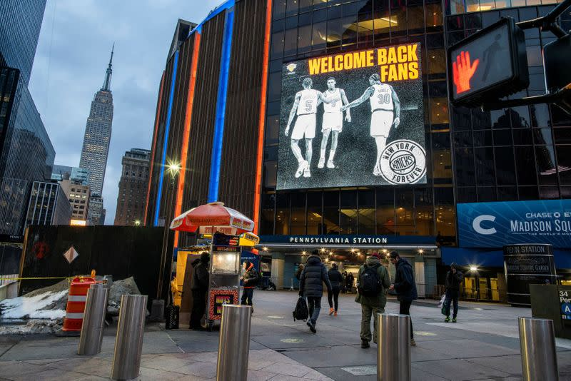 People walk outside Madison Square Garden before a Knicks game amid the coronavirus disease (COVID-19) pandemic in the Manhattan borough of New York City, New York