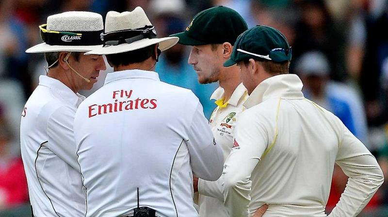 Umpires confronted Cameron Bancroft after he was caught tampering with the ball. Source: Getty