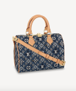 """<p><strong>Louis Vuitton</strong></p><p>louisvuitton.com</p><p><strong>$2310.00</strong></p><p><a href=""""https://us.louisvuitton.com/eng-us/products/since-1854-speedy-bandouliere-25-monogram-jacquard-since-1854-nvprod2490026v#M57400"""" rel=""""nofollow noopener"""" target=""""_blank"""" data-ylk=""""slk:Shop Now"""" class=""""link rapid-noclick-resp"""">Shop Now</a></p><p>Because it's go blue, or go home in the land of Speedys. </p>"""
