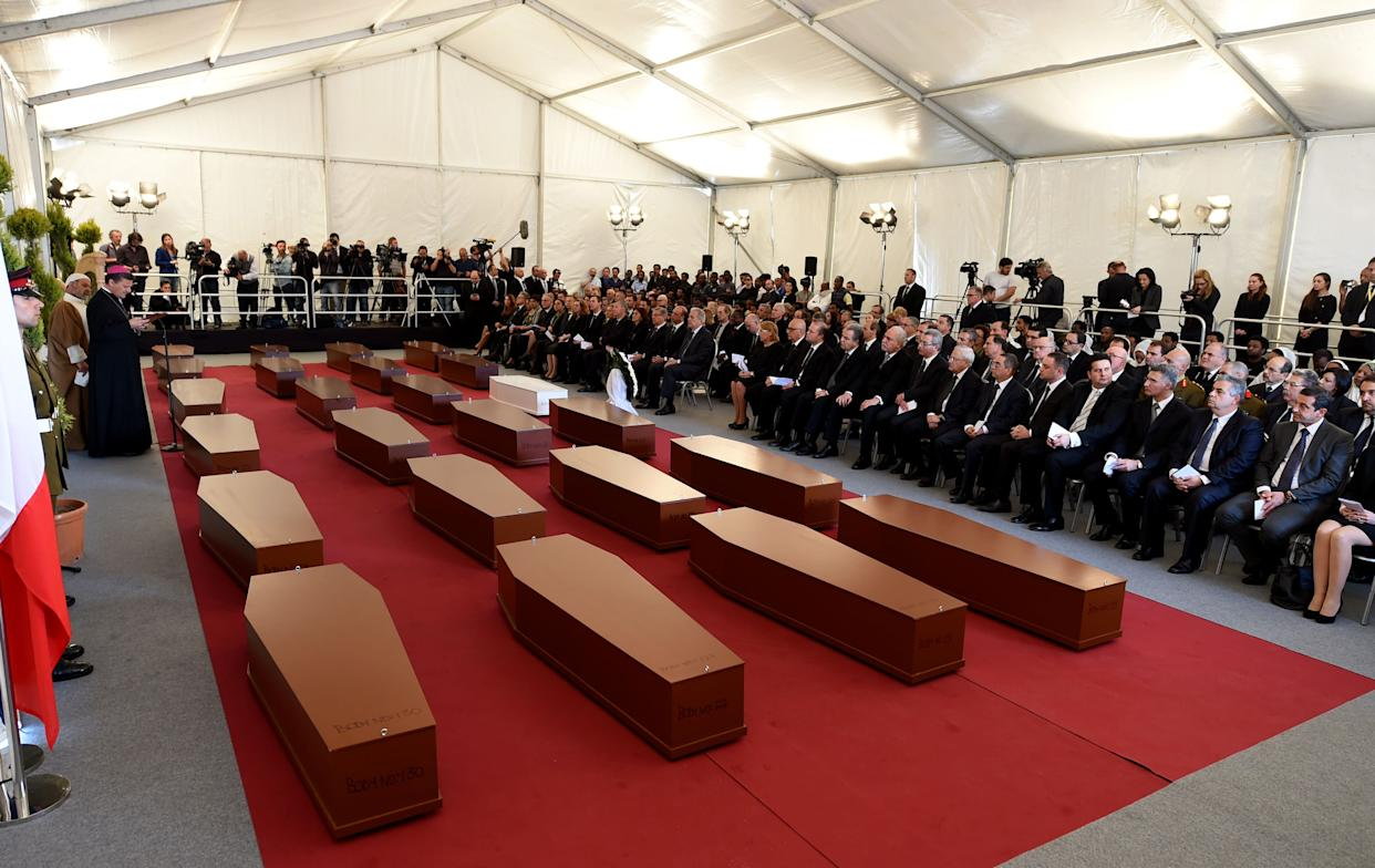 MSIDA, MALTA - APRIL 23: Friends and families attend the funeral service for 24 drowned Mediterranean refugees on April 23, 2015 in Msida, Malta. Up to 920 refugees died while trying to reach the Southern coasts of Italy, when the ship carrying them capsized in waters between the Italian island of Lampedusa and Libya. PHOTOGRAPH BY James Galea / Barcroft Media (Photo credit should read James Galea / Barcroft Media via Getty Images)