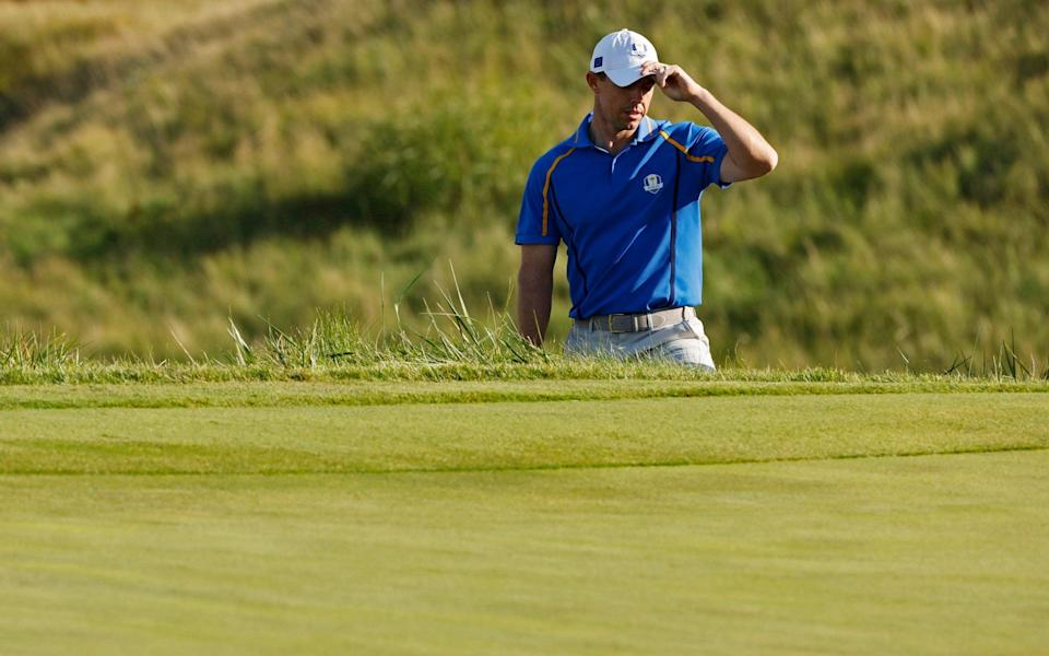 Team Europe's Rory McIlroy reacts during the Four-balls - Reuters