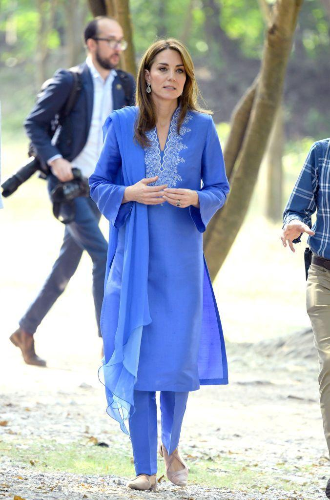 "<p>For her first full day of engagements in Pakistan, Kate wore a vibrant periwinkle kurta by a. local designer. <a href=""https://www.townandcountrymag.com/society/tradition/a29443456/kate-middleton-blue-kurta-maheen-khan-pakistan-photos/"" rel=""nofollow noopener"" target=""_blank"" data-ylk=""slk:Get all the details here."" class=""link rapid-noclick-resp"">Get all the details here. </a></p>"