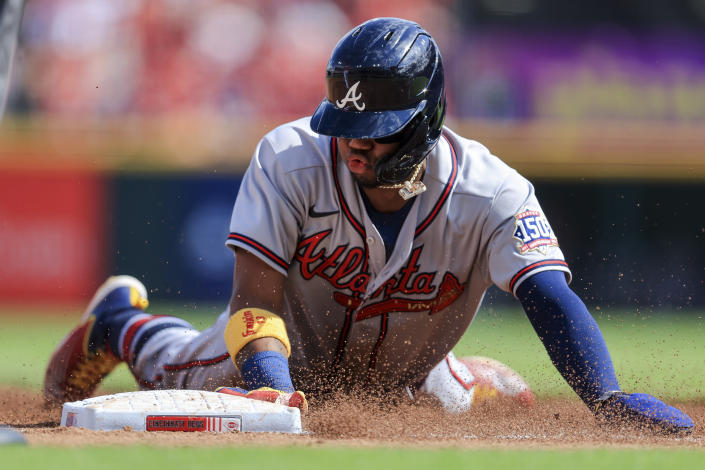 Atlanta Braves' Ronald Acuna Jr. slides safely into third base during the third inning of a baseball game against the Cincinnati Reds in Cincinnati, Saturday, June 26, 2021. (AP Photo/Aaron Doster)