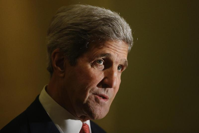 US Secretary of State John Kerry makes statements to the press in Cairo July 21, 2014 (AFP Photo/Charles Dharapak)