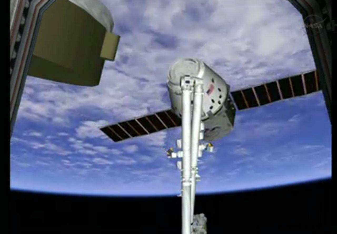 This frame grab made available by NASA TV shows a view of the SpaceX Dragon capsule on the end of the International Space Station's robotic arm, Sunday, March 3, 2013. SpaceX, the California-based company founded by billionaire Elon Musk, had to struggle with the Dragon following its launch Friday from Cape Canaveral. The spacecraft is delivering more than 1 ton of supplies to the the International Space Station. (AP Photo/NASA TV)
