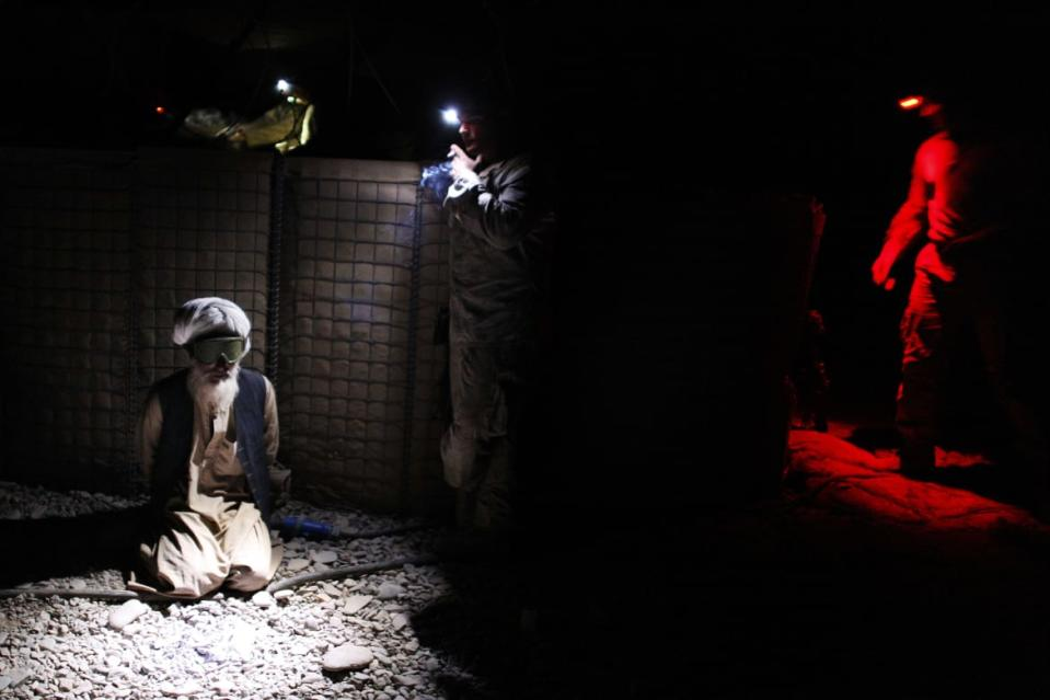"<div class=""inline-image__caption""><p>An Afghan man is detained by U.S. Marines from the First Battalion, Eighth Marines Bravo Company at their base in Talibjan after a battle against Taliban insurgents in Musa Qala district in southern Afghanistan's Helmand province November 7, 2010. </p></div> <div class=""inline-image__credit"">Finbarr O'Reilly/Reuters</div>"