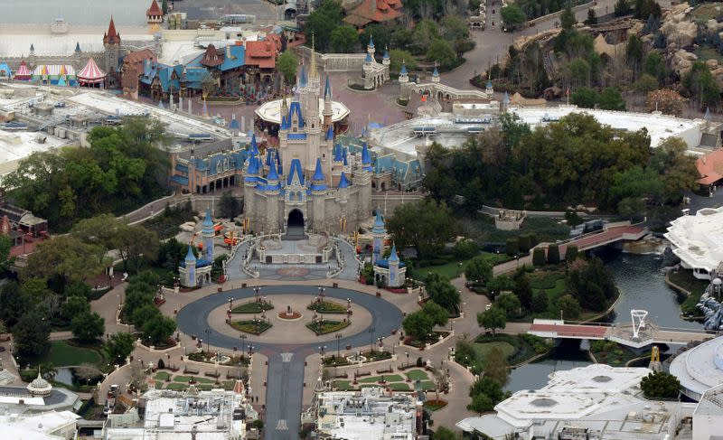 Disney might check visitors' temperatures when theme parks reopen, chairman says