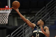 Milwaukee Bucks forward Giannis Antetokounmpo (34) puts in a layup during the first half of an NBA basketball game against the Toronto Raptors Wednesday, Jan. 27, 2021, in Tampa, Fla. (AP Photo/Chris O'Meara)