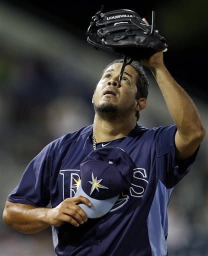 Tampa Bay Rays relief pitcher Joel Peralta gestures after working the eighth inning of an exhibition spring training baseball game against the Pittsburgh Pirates in Port Charlotte, Fla., Monday, March 25, 2013. The Rays won 6-2. (AP Photo/Elise Amendola)