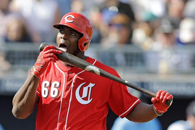 The Reds have to hope Yasiel Puig's love for the game increases on his new team. (AP Photo/Darron Cummings)