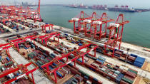 This photo shows an aerial view of a new automated container port in Rizhao in eastern China's Shandong province on Oct. 9, 2021. China's import and export growth slowed in September amid shipping bottlenecks and other disruptions combined with coronavirus outbreaks.(Chinatopix via AP)