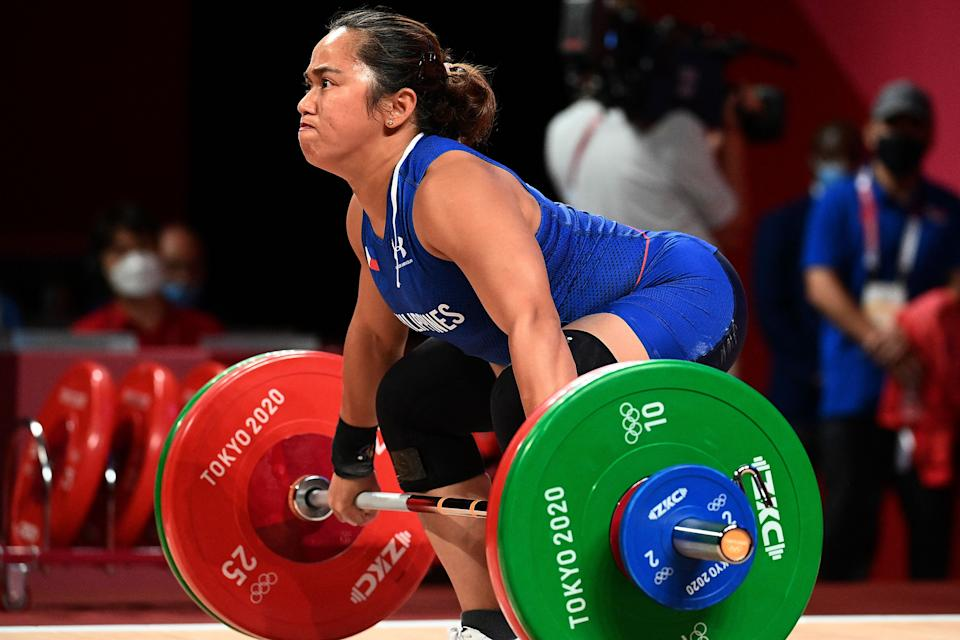 Philippines' Hidilyn Diaz competes in the women's 55kg weightlifting competition during the Tokyo 2020 Olympic Games at the Tokyo International Forum in Tokyo on July 26, 2021. (Photo by Vincenzo PINTO / AFP) (Photo by VINCENZO PINTO/AFP via Getty Images)