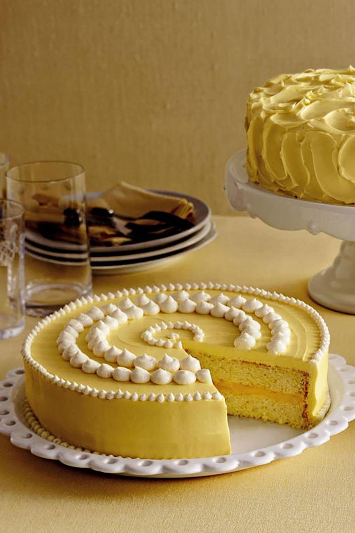 """<p>With a lemon curd filling (raspberry jam or frosting works as well), this moist, fluffy cake is fairly simple and makes an elegant addition to your Mother's Day table.</p><p><strong><a href=""""https://www.countryliving.com/food-drinks/recipes/a2268/lemon-cake-clv/"""" rel=""""nofollow noopener"""" target=""""_blank"""" data-ylk=""""slk:Get the recipe"""" class=""""link rapid-noclick-resp"""">Get the recipe</a>.</strong></p><p><a class=""""link rapid-noclick-resp"""" href=""""https://go.redirectingat.com?id=74968X1596630&url=https%3A%2F%2Fwww.williams-sonoma.com%2Fproducts%2Fkitchenaid-artisan-mini-with-flex-edge-beater%2F&sref=https%3A%2F%2Fwww.countryliving.com%2Ffood-drinks%2Fg3185%2Fmothers-day-cakes%2F"""" rel=""""nofollow noopener"""" target=""""_blank"""" data-ylk=""""slk:SHOP STAND MIXERS"""">SHOP STAND MIXERS</a></p>"""