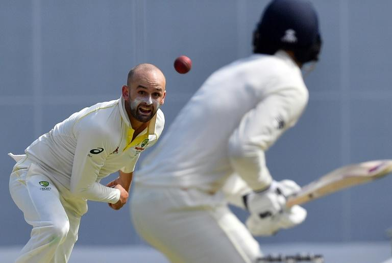 Australia's Nathan Lyon (left) bowls to England's James Vince on the first day of the first Ashes Test in Brisbane, on November 23, 2017