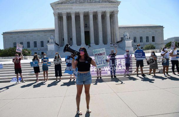 PHOTO: People in front of the Supreme Court in Washington, D.C., on June 29, 2020. (Nicholas Kamm/AFP via Getty Images)