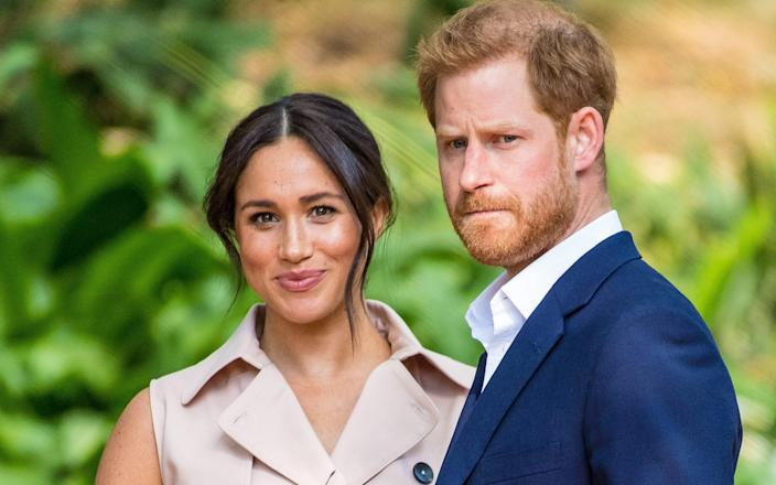 Harry and Meghan are 'stepping back' from the Royal family - Splash News