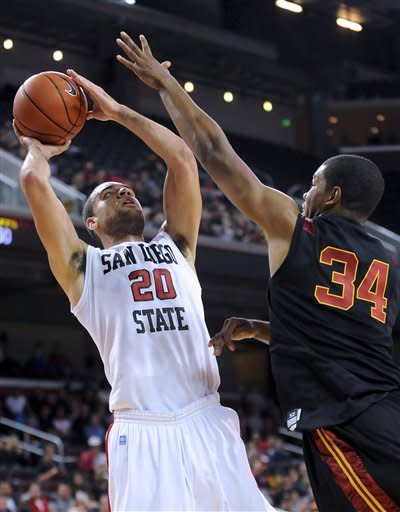 San Diego State forward JJ O'Brien (20) shoots over Southern California forward Eric Wise (34) for a basket during the first half of an NCAA college basketball game, Sunday, Nov. 25, 2012, in Los Angeles. (AP Photo/Gus Ruelas)