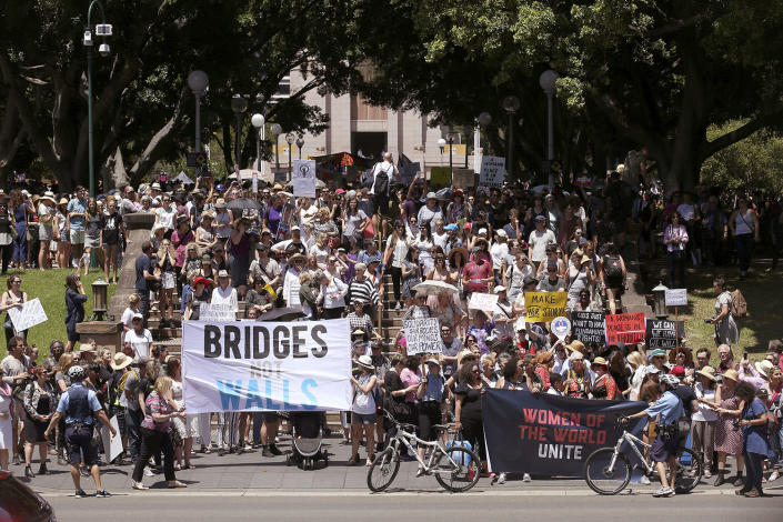 <p>People gather at Hyde Park during the Women's March rally protesting the start of Donald Trump's presidency, in Sydney Jan. 21. (AP Photo/Rick Rycroft) </p>