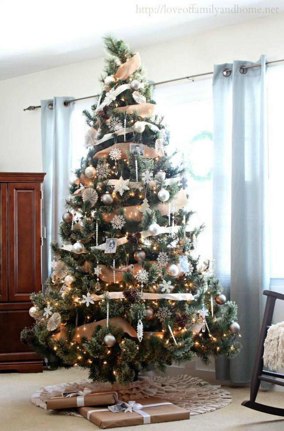 """<p>Wrap a rustic burlap garland around your tree then add sparkling ornaments and delicate snowflakes for a glamorous look.</p><p><em><strong>Get the tutorial at </strong><strong><a href=""""https://loveoffamilyandhome.net/2013/12/neutral-rustic-glam-christmas-tree.html"""" rel=""""nofollow noopener"""" target=""""_blank"""" data-ylk=""""slk:Love of Family and Home."""" class=""""link rapid-noclick-resp"""">Love of Family and Home.</a></strong></em></p><p><a class=""""link rapid-noclick-resp"""" href=""""https://www.amazon.com/dp/B07MHL54GT/?tag=syn-yahoo-20&ascsubtag=%5Bartid%7C10070.g.2025%5Bsrc%7Cyahoo-us"""" rel=""""nofollow noopener"""" target=""""_blank"""" data-ylk=""""slk:BUY BURLAP"""">BUY BURLAP</a></p>"""