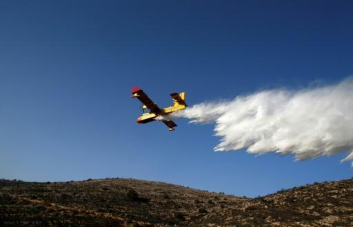 Israel extinguishes fires that forced mass evacuations
