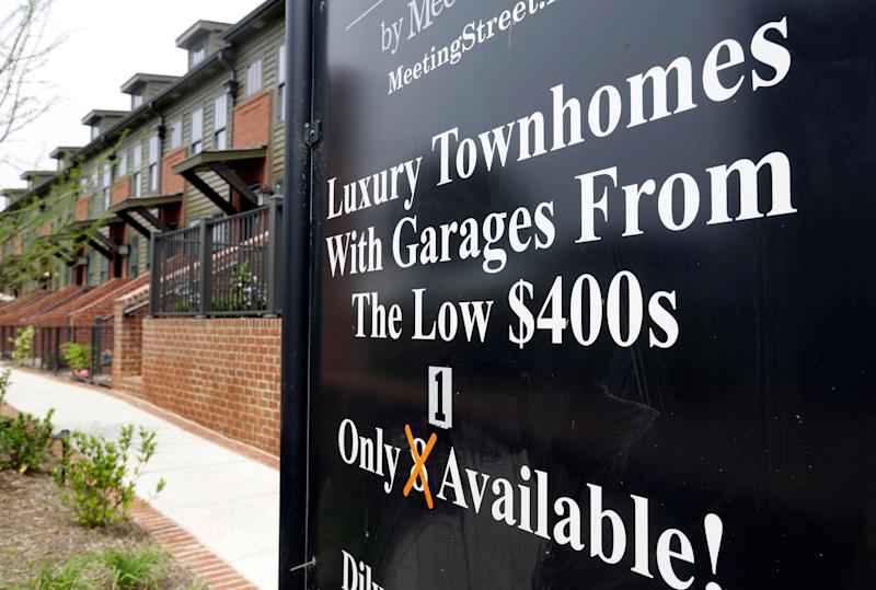 FILE - This Thursday, April 27, 2017, file photo shows a sign promoting town homes for sale, in Charlotte, N.C. A healthy demand for homes and a shrinking supply of available properties has helped keep home prices rising. The Standard & Poor's CoreLogic Case-Shiller home price index, which tracks the value of homes in 20 major U.S. metropolitan areas, is due out Tuesday, Dec. 26, 2017. (AP Photo/Chuck Burton, File)