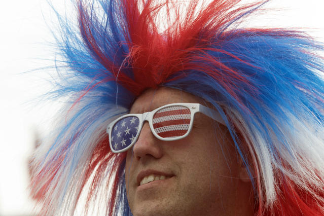 <p>Brad Kleinschmidtof Muncie, Indiana, wears a patriotic outfit to watch his wife Holly Titus compete in the Nathan's Famous Fourth of July hot dog eating contest, Wednesday, July 4, 2018, in New York's Coney Island. (Photo: Mary Altaffer/AP) </p>