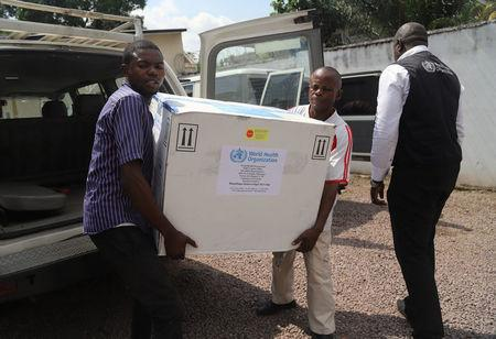 FILE PHOTO: Congolese Health Ministry officials carry the first batch of experimental Ebola vaccines in Kinshasa