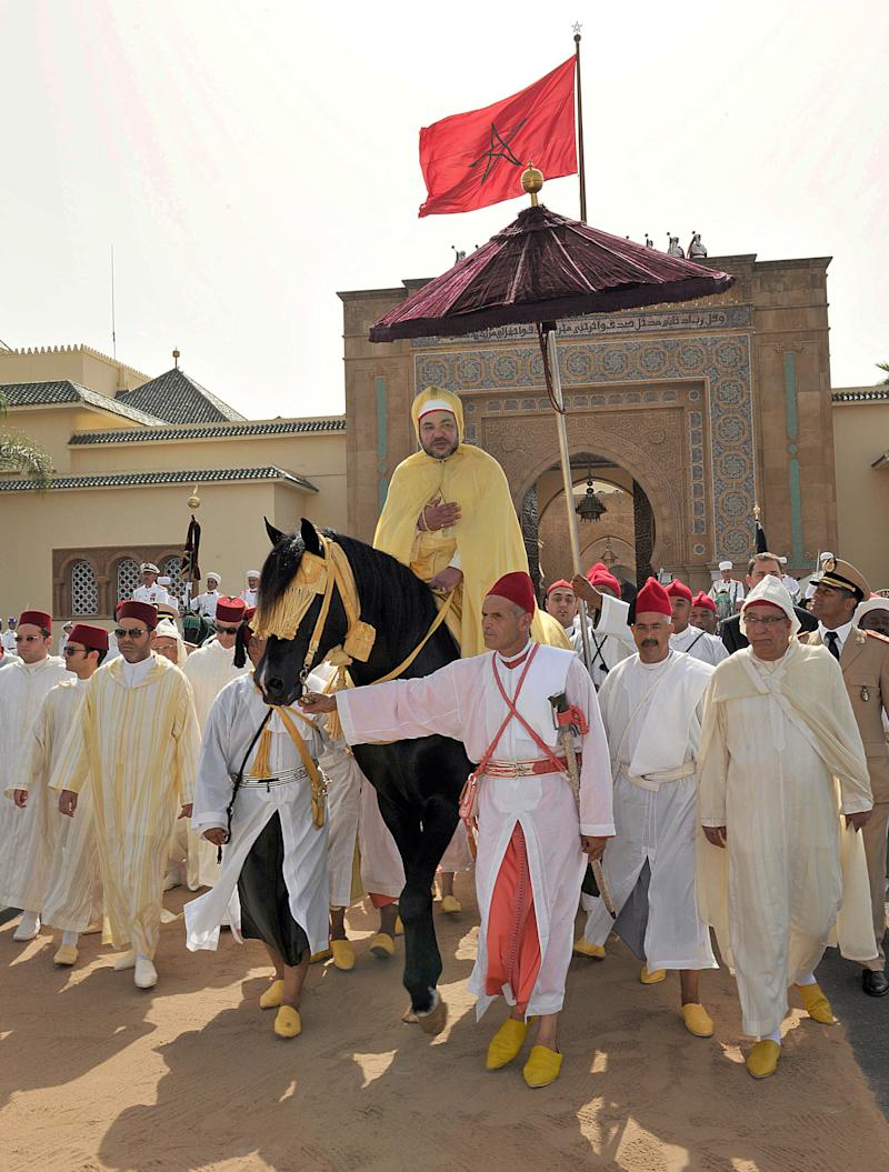 """FILE - In this Aug. 21, 2012 file photo photo provided by the Moroccan Royal Palace, Moroccan King Mohammed VI seen while riding a horse during a ceremony of allegiance in Rabat, Morocco. Every year, hundreds of civil servants and elected officials from all over the country must gather at one of King Mohammed VI's palaces to pledge allegiance to the """"Commander of the Faithful"""" in a tribute that critics say is increasingly outdated. The subservience points to the contradictions in a nation that quelled Arab Spring protests by promising the people a greater voice.  (AP Photo/ Azzouz Boukallouch, Moroccan Royal Palace, file)"""