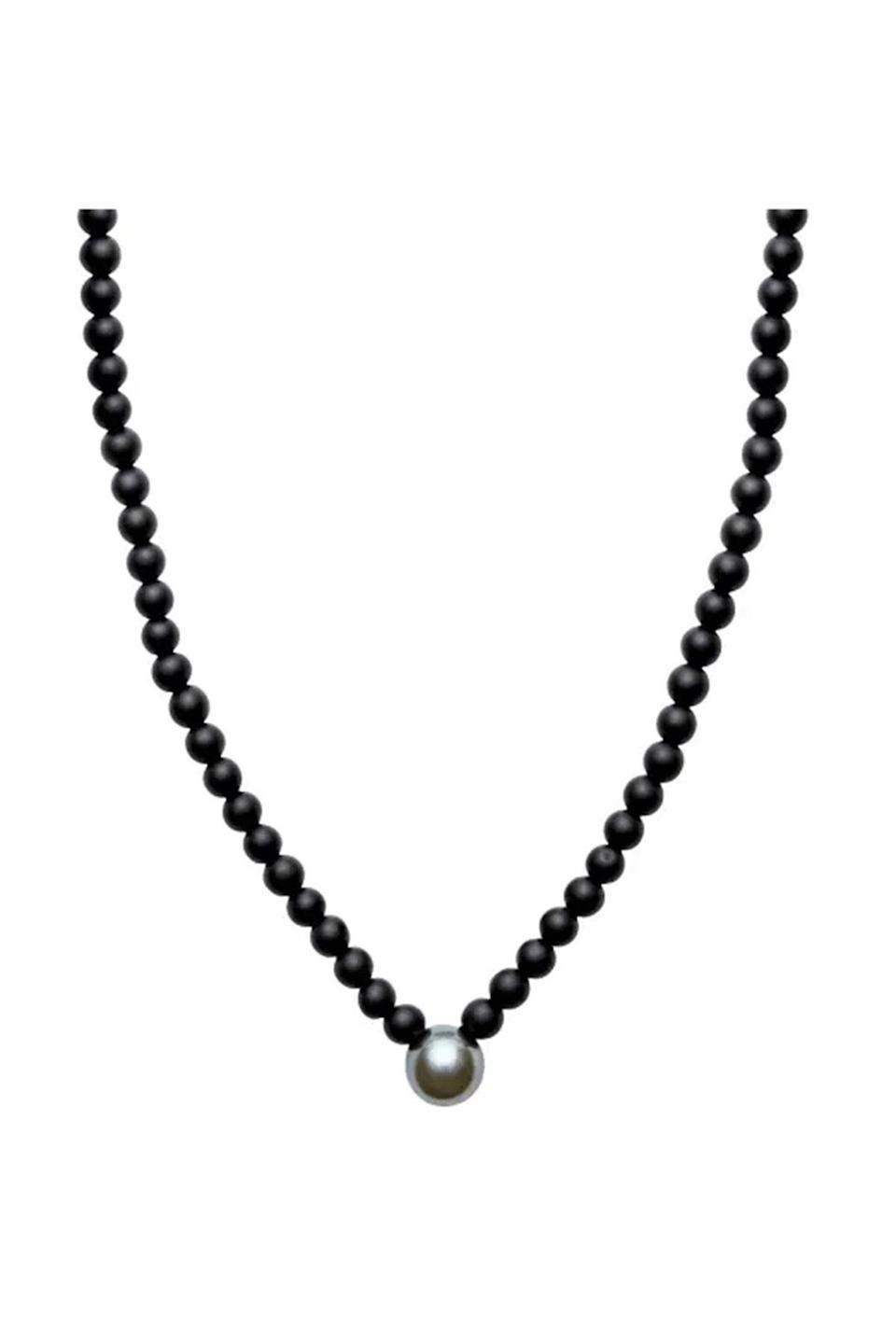"""<p><strong>ORA Pearls</strong></p><p>wolfandbadger.com</p><p><strong>$356.00</strong></p><p><a href=""""https://go.redirectingat.com?id=74968X1596630&url=https%3A%2F%2Fwww.wolfandbadger.com%2Fus%2Faro-men-s-round-tahitian-pearl-matt-onyx-v-shape-necklace%2F&sref=https%3A%2F%2Fwww.townandcountrymag.com%2Fstyle%2Fjewelry-and-watches%2Fg36793443%2Fbest-mens-pearl-jewelry%2F"""" rel=""""nofollow noopener"""" target=""""_blank"""" data-ylk=""""slk:Shop Now"""" class=""""link rapid-noclick-resp"""">Shop Now</a></p><p>This pearl and onyx necklace delivers some serious sultriness with a mix of textures and dark hues.</p>"""