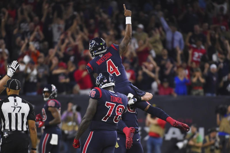 Houston Texans quarterback Deshaun Watson (4) is lifted as he celebrates a touchdown pass with teammates during the second half of an NFL football game against the Indianapolis Colts Thursday, Nov. 21, 2019, in Houston. (AP Photo/Eric Christian Smith)