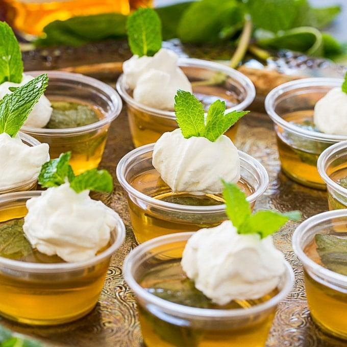 """<p>You know it's a celebration when Jell-O shots are involved! These mint julep goodies have bourbon, mint, and sugar, plus a scoop of mint-flavored whipped cream on top that'll make your taste buds swoon. </p> <p><strong>Get the recipe</strong>: <a href=""""https://spicysouthernkitchen.com/mint-julep-jello-shots/"""" class=""""link rapid-noclick-resp"""" rel=""""nofollow noopener"""" target=""""_blank"""" data-ylk=""""slk:mint julep Jell-O shots"""">mint julep Jell-O shots</a></p>"""