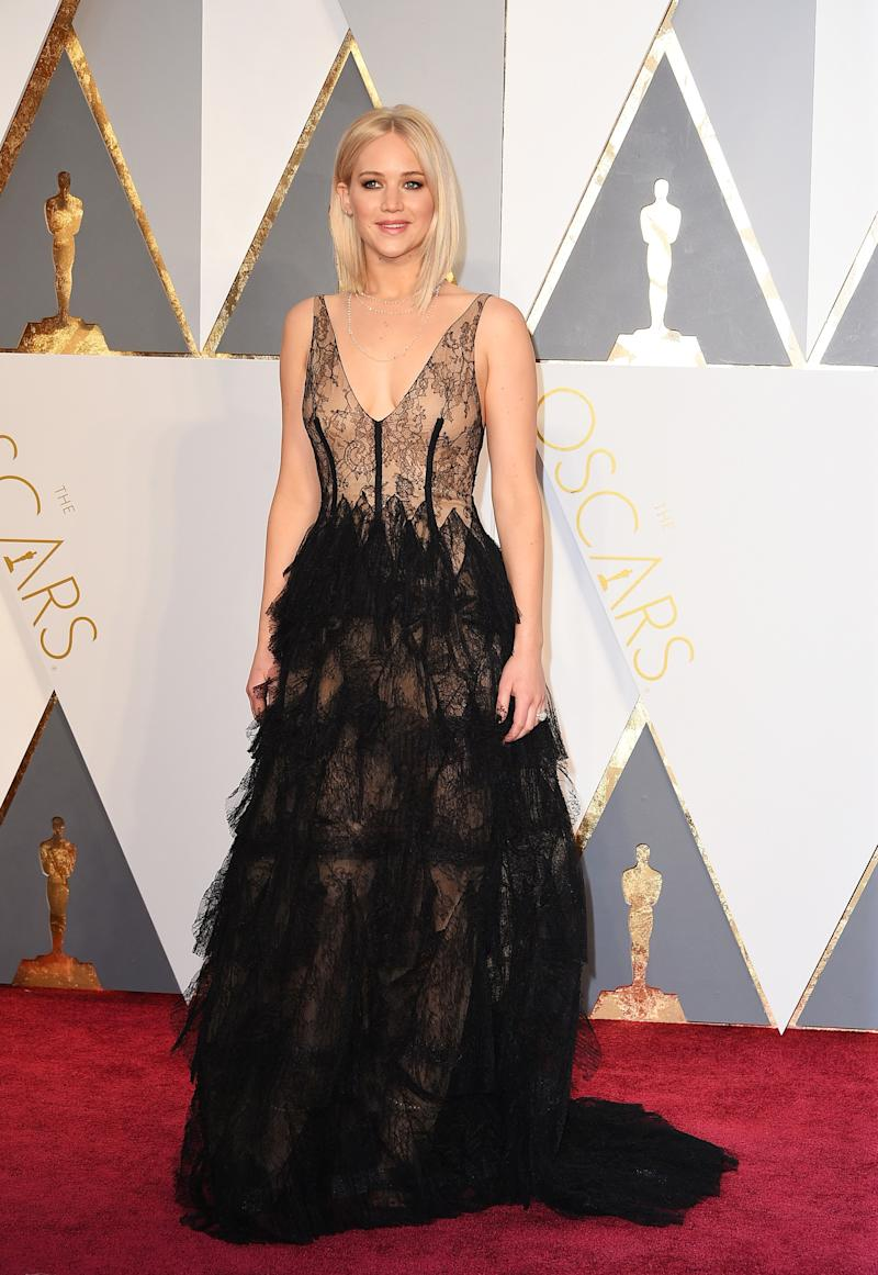 Debuting her new platinum blonde bob, Lawrence looked sensational in a Dior sheer lace gown with a plunging neckline and feather-adorned waistline for the 88th annual Academy Awards in Hollywood, California.
