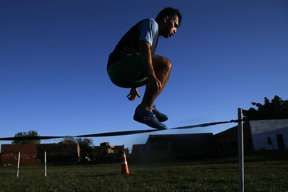 Midfielder Fulvio Duarte, of the Fulgencio Yegros Club trains in the Mariano Roque Alonso district of greater Asuncion, Paraguay, Friday, Feb. 5, 2021. Because the soccer championship was suspended due to the COVID-19 lockdown, Duarte, 31, has not received his salary in over a year. (AP Photo/Jorge Saenz)
