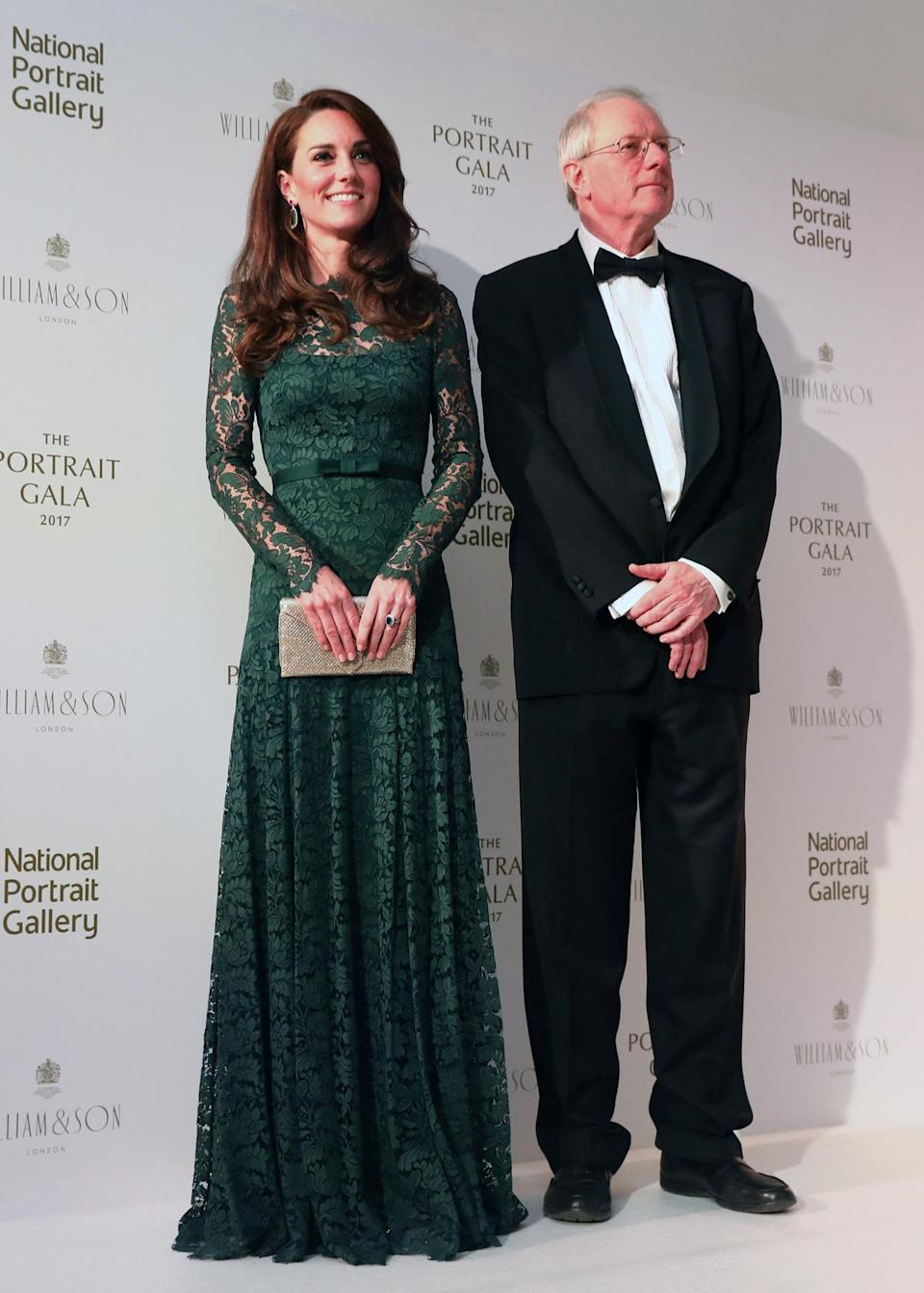 <p>Kate was a complete vision in an emerald lacy gown by Temperley London. Attending her second National Portrait Gala, the Duchess stole the show in the floor-length look accompanied by golden accessories: a glitter clutch by Wilbur and Gussie and strappy Jimmy Choo sandals.</p><p><i>[Photo: PA]</i> </p>