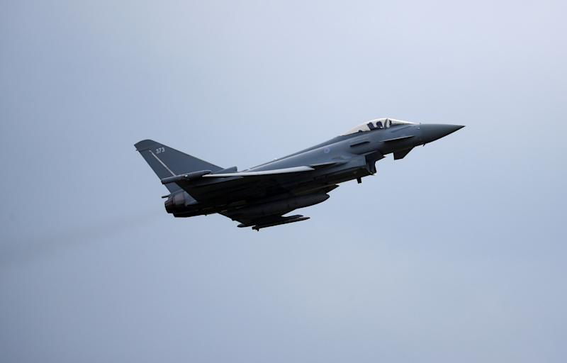 An RAF Typhoon jet takes off during a visit by the Duke of Cambridge to RAF Coningsby in Lincolnshire.