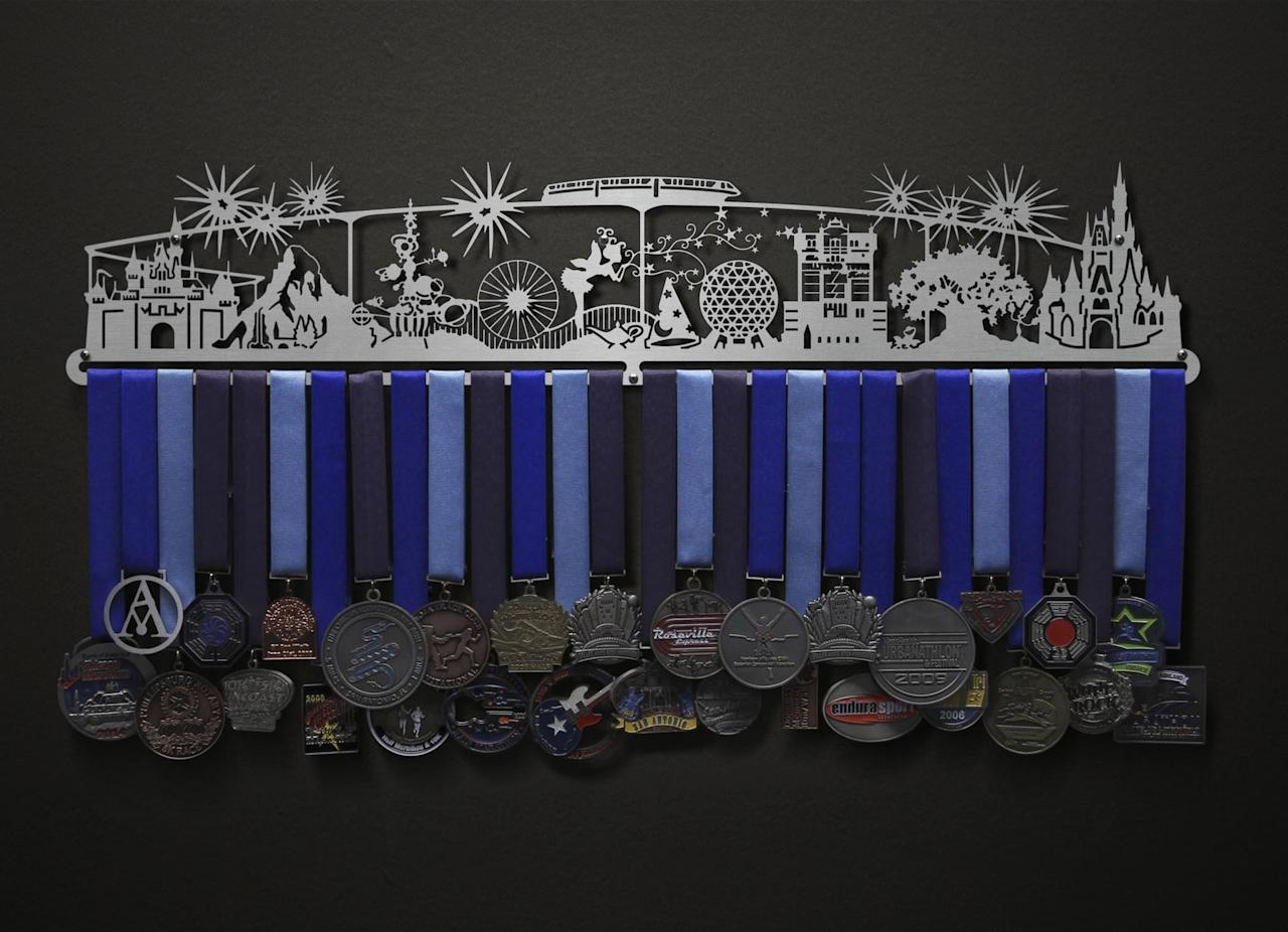 """<p>I keep my RunDisney medals on proud display with this <a href=""""https://www.popsugar.com/buy/Allied-Medal-Magic-Scape-Hanger-511922?p_name=Allied%20Medal%20Magic%20Scape%20Hanger&retailer=medalhangers.com&pid=511922&price=89&evar1=fit%3Aus&evar9=46802629&evar98=https%3A%2F%2Fwww.popsugar.com%2Fphoto-gallery%2F46802629%2Fimage%2F46852475%2FAllied-Medal-Magic-Scape-Hanger&prop13=api&pdata=1"""" rel=""""nofollow"""" data-shoppable-link=""""1"""" target=""""_blank"""" class=""""ga-track"""" data-ga-category=""""Related"""" data-ga-label=""""https://www.medalhangers.com/view/700/Magic-Scape-Magic-World--Magic-Land-"""" data-ga-action=""""In-Line Links"""">Allied Medal Magic Scape Hanger</a> ($89-$99). The brand offers cityscapes, too.</p>"""