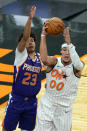 Orlando Magic forward Aaron Gordon (00) looks to pass as he is defended by Phoenix Suns forward Cameron Johnson (23) during the second half of an NBA basketball game, Wednesday, March 24, 2021, in Orlando, Fla. (AP Photo/John Raoux)
