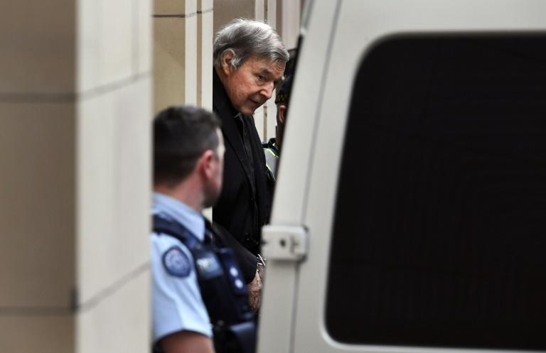 Australian Cardinal George Pell is escorted in handcuffs from the Supreme Court of Victoria in Melbourne on August 21, 2019