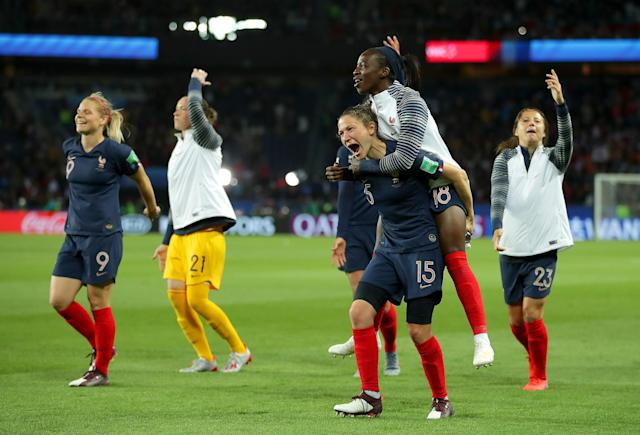 Elise Bussaglia and Viviane Asseyi of France celebrate following the 2019 FIFA Women's World Cup France group A match between France and Korea Republic at Parc des Princes on June 07, 2019 in Paris, France. (Photo by Richard Heathcote/Getty Images)