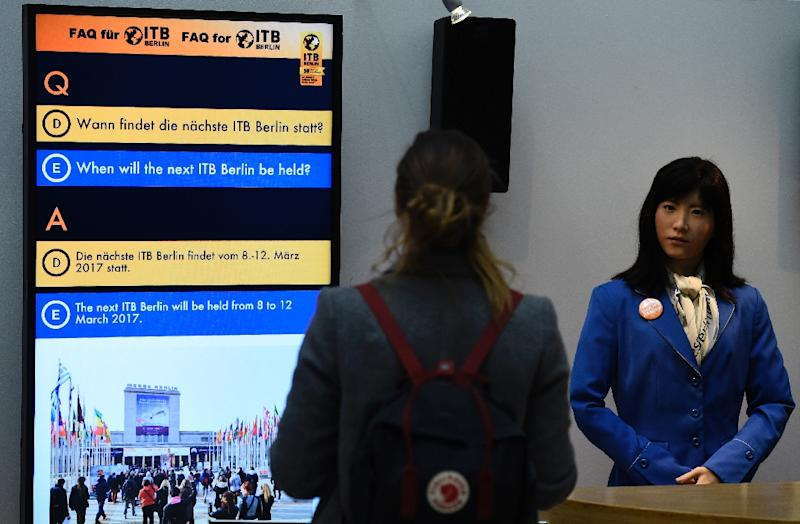 At an entrance to Berlin's exhibition hall where thousands of travel industry professionals are gathering for the ITB trade show, humanoid robot ChihiraKanae greets visitors -- in English, German, Chinese and Japanese