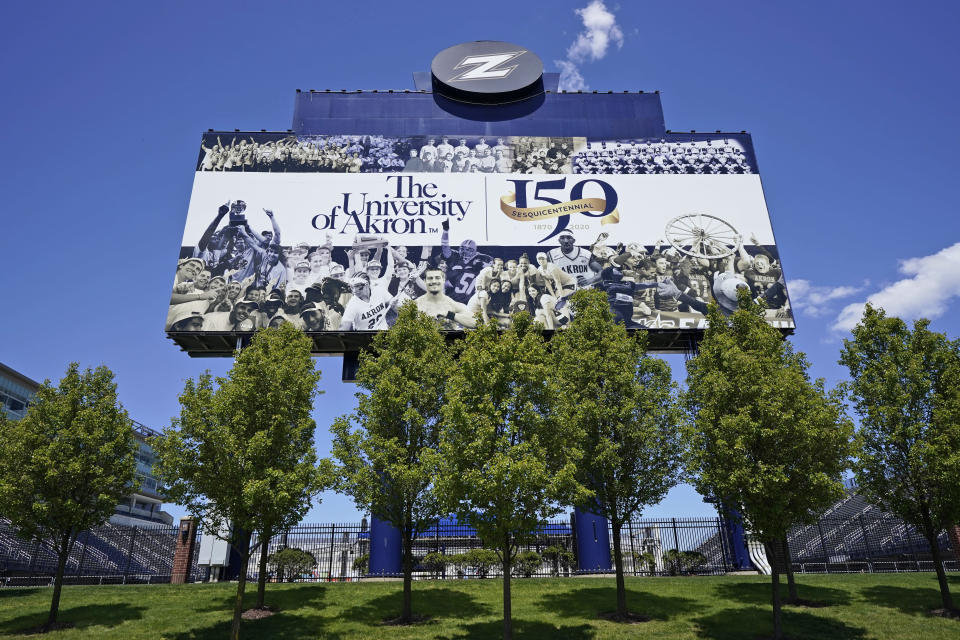 A billboard at the University of Akron is displayed, Thursday, May 13, 2021, in Akron, Ohio. Ohio Gov. Mike DeWine recently announced a weekly $1 million prize and full-ride college scholarships to entice more Ohioans to get the COVID-19 vaccine. (AP Photo/Tony Dejak)