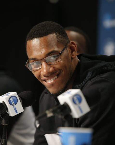 Wichita State's Carl Hall smiles during a news conference in Los Angeles, Friday, March 29, 2013. Wichita State is to play Ohio State in the West Regional finals of the NCAA college basketball tournament on Saturday. (AP Photo/Jae C. Hong)