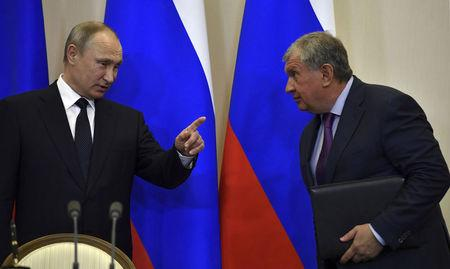 FILE PHOTO: Russian President Putin gestures as he talks with Rosneft CEO Sechin during signing ceremony following meeting with Italian PM Gentiloni at Bocharov Ruchei state residence in Sochi